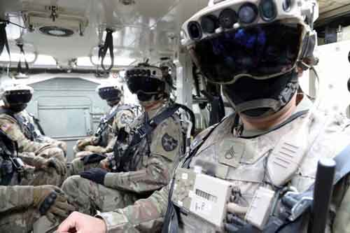 Photo of soldiers inside a Bradley troop carrier wearing HoloLens 2 IVAS virtual-reality goggles